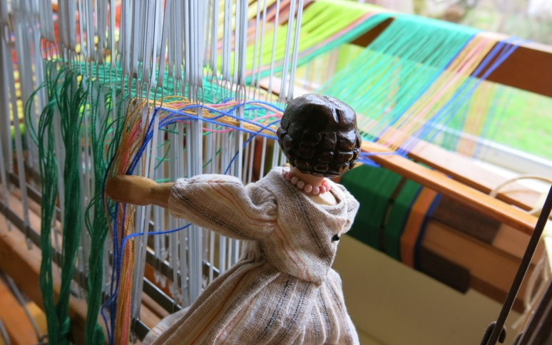Double-checking the warps in the heddles.