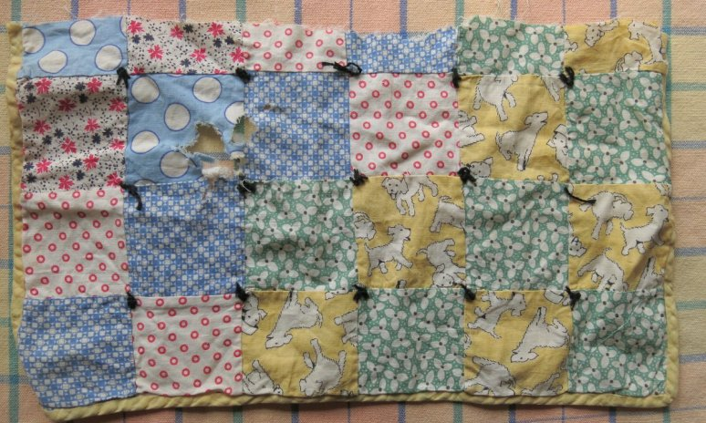 Old piece of a Doll Quilt
