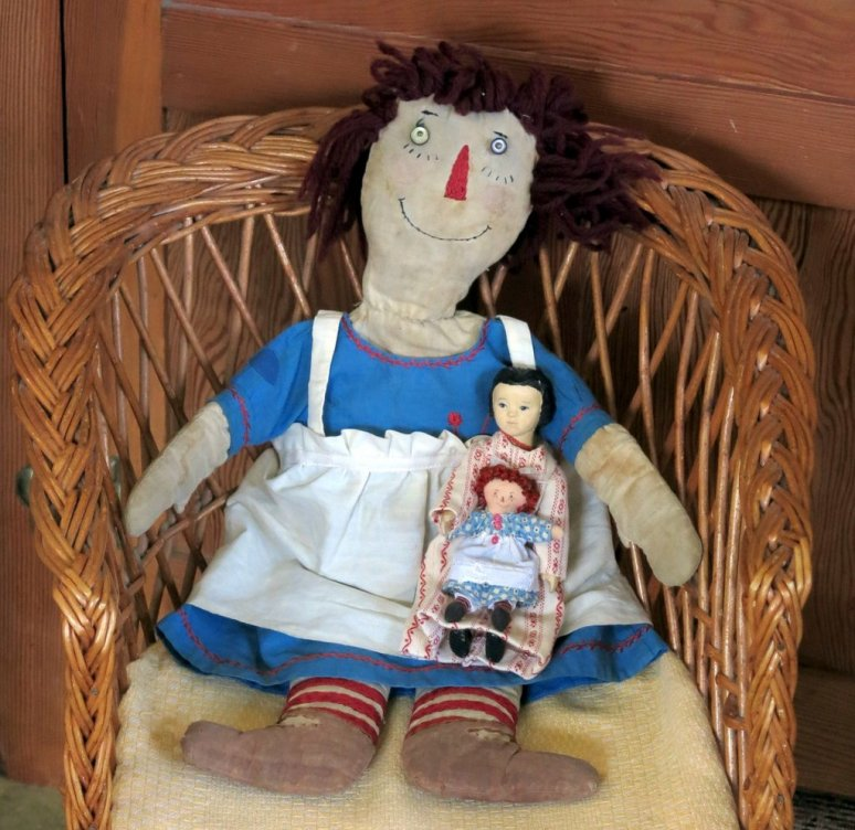 New eyes, eye lashes, smile, and mended dress and apron, but the thing that makes Raggedy Ann happiest is that she is sitting with friends