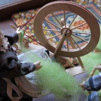 Spinning Green Wool